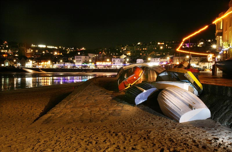 st ives harbour with boats at night