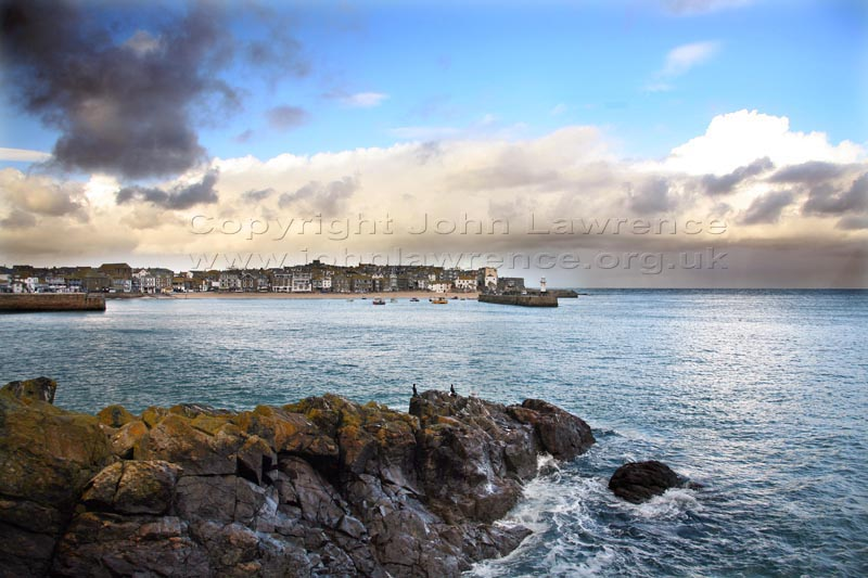 st ives harbour with seagulls perched on rocks