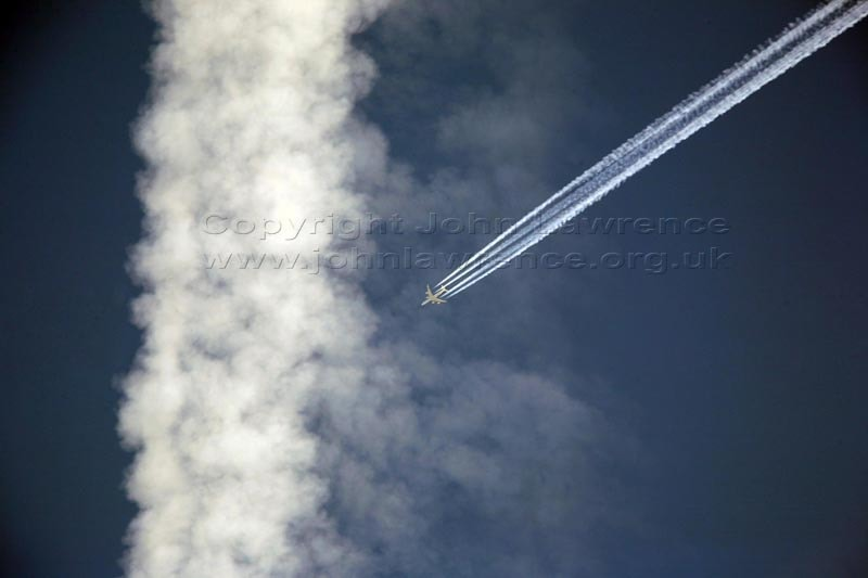 plane flying through contrails